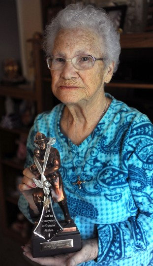 Evelyn Rayner, mother of Henry Rayner, who was a Baltimore county firefighter killed in the line of duty in 1986, holds a statuette she purchased to honor him. Henry was honored in the first Fallen Heroes ceremony. (Barbara Haddock Taylor/Baltimore Sun)