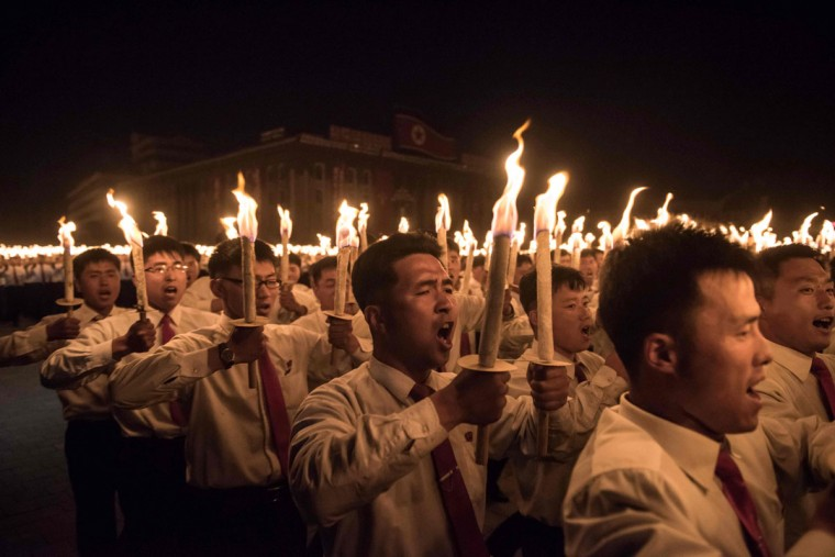 Performers take part in a torchlight parade on Kim Il-Sung square during festivities marking the end of the 7th Workers Party Congress in Kim Il-Sung square in Pyongyang on May 10, 2016. (ED JONES/AFP/Getty Images)