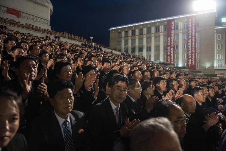 Spectators applaud during a torchlight parade on Kim Il-Sung square during festivities marking the end of the 7th Workers Party Congress in Pyongyang on May 10, 2016. (ED JONES/AFP/Getty Images)