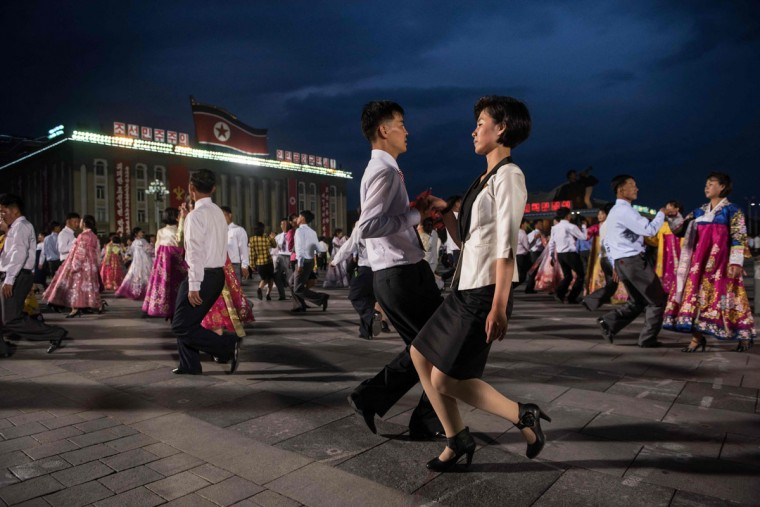 Performers take part in a mass dance on Kim Il-Sung square following a parade to mark the end of the 7th Workers Party Congress in Pyongyang on May 10, 2016. (ED JONES/AFP/Getty Images)