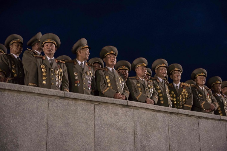 Military officers attend a torchlight parade on Kim Il-Sung square during festivities marking the end of the 7th Workers Party Congress in Pyongyang on May 10, 2016. (ED JONES/AFP/Getty Images)