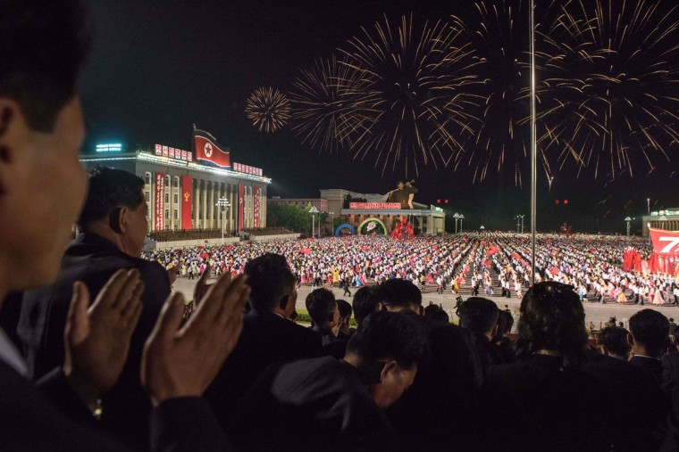 Spectators applaud during a parade on Kim Il-Sung square during festivities marking the end of the 7th Workers Party Congress in Kim Il-Sung square in Pyongyang on May 10, 2016. (ED JONES/AFP/Getty Images)