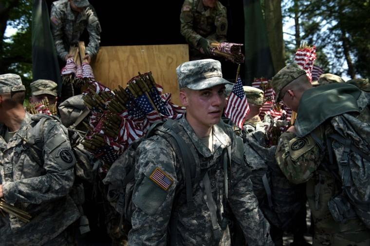 Members of the US Army stock up on American flags before placing them at graves in Arlington National Cemetery on May 26, 2016 in Arlington, Virginia in preparation for Memorial Day. (BRENDAN SMIALOWSKI/AFP/Getty Images)