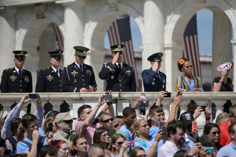 People watch as President Barack Obama places a wreath at the Tomb of the Unknowns to honor Memorial Day at Arlington National Cemetery May 30, 2016 in Arlington, Virginia. (BRENDAN SMIALOWSKI/AFP/Getty Images)