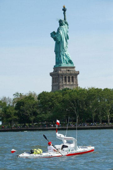 "Polish kayaker Aleksander Doba sails next to Statue Liberty at the start of his translatlantic kayak adventure from New York to Lisbon on May 29, 2016 in New York. Doba says this will be his toughest challenge yet, but that he feels like a young man and ""will not pretend to be old."" (EDUARDO MUNOZ ALVAREZ/AFP/Getty Images)"