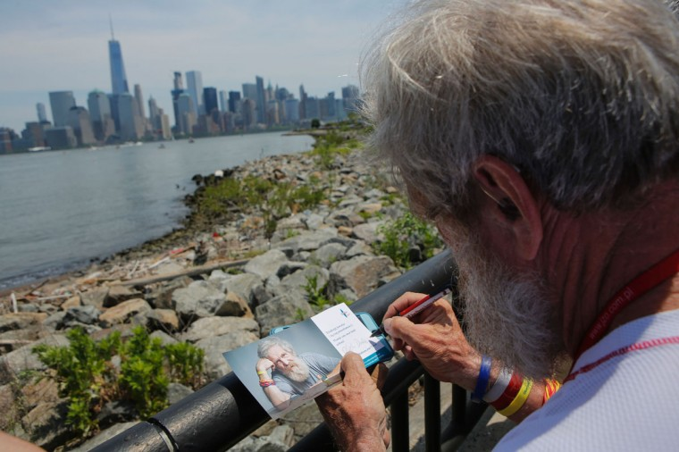 "Polish kayaker Aleksander Doba signs flyers before the beginning of his transatlantic kayak adventure from New York to Lisbon on May 29, 2016 in New York. Doba says this will be his toughest challenge yet, but that he feels like a young man and ""will not pretend to be old."" (EDUARDO MUNOZ ALVAREZ/AFP/Getty Images)"