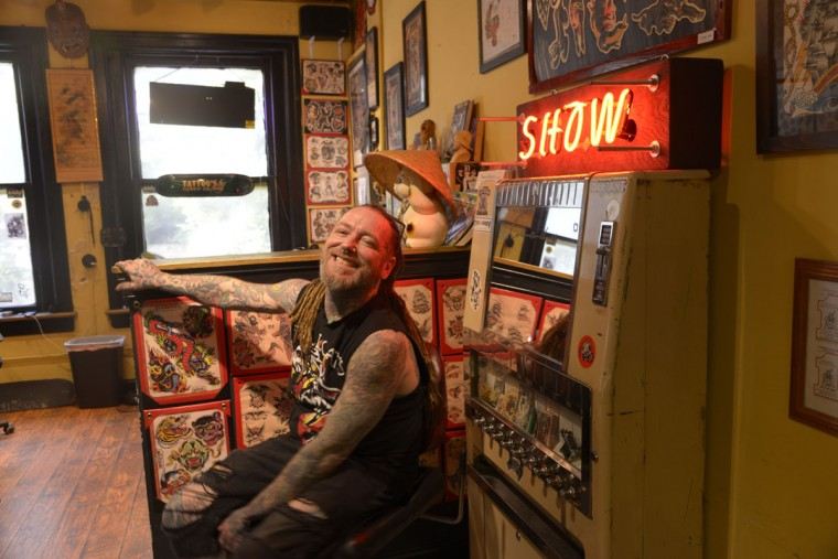 Gary Clark, originally of New Jersey, is a tattoo artist at Tattoo Charlie's. He'd like to see more people coming through the shop, but says business is rough on the Block. (Christina Tkacik/Baltimore Sun)