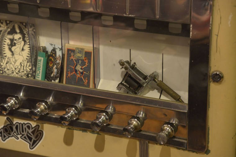 Evidence of Tattoo Charlies' founder Charlie Geizer is everywhere at the shop: his original tattoo machine is even on view. (Christina Tkacik/Baltimore Sun)
