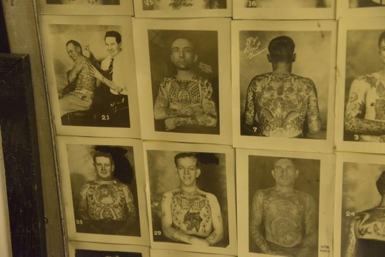 Vintage designs on the walls of Tattoo Charlie's on the Block. (Christina Tkacik/Baltimore Sun)