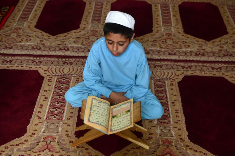 An Afghan boy studies the Koran during the Islamic holy month of Ramadan at a mosque in Herat on June 15, 2016. Muslims throughout the world are marking the month of Ramadan, the holiest month in the Islamic calendar during which devotees fast from dawn till dusk. (Aref Karimi/AFP/Getty Images)