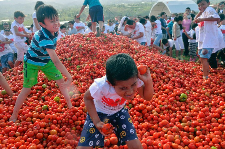 """Children participate in the 10th annual tomato fight festival, known as """"tomatina"""", in Sutamarchan, Boyaca department, Colombia, on June 5, 2016. (GUILLERMO LEGARIA/AFP/Getty Images)"""