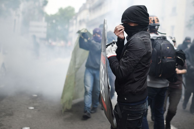 Protesters clash with French riot police during a demonstration against the government's labour market reforms on June 2, 2016 in Nantes, western France. More demonstrations against the reforms which the government says are designed to make France more business-friendly -- were set to take place in major cities on June 2 and nuclear power workers were back on strike at 16 of the country's 19 power stations. (Jean-Sebastien Evrard/AFP/Getty Images)