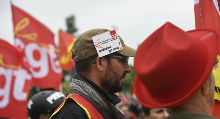 "A protester wearing a badge reading ""Unionist, no rogue !"" attends a demonstration against the government's labour market reforms in Rennes, northwestern France, on June 2, 2016. Thousands took to the streets across the country on Thursday in the latest demonstrations against the labour law reforms, which the government says are designed to make France more business-friendly. In Rennes, the police charged the protesters with the help of vehicles, leaving several injured. / (Damien Meyer/AFP/Getty Images)"
