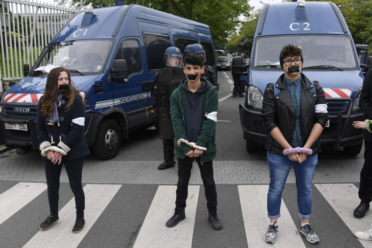 Gagged protesters with makeup scars look on as they protest against the government's labour market reforms in Rennes, northwestern France, on June 2, 2016. Thousands took to the streets across the country on Thursday in the latest demonstrations against the labour law reforms, which the government says are designed to make France more business-friendly. In Rennes, the police charged the protesters with the help of vehicles, leaving several injured. (Damien Meyer/AFP/Getty Images)