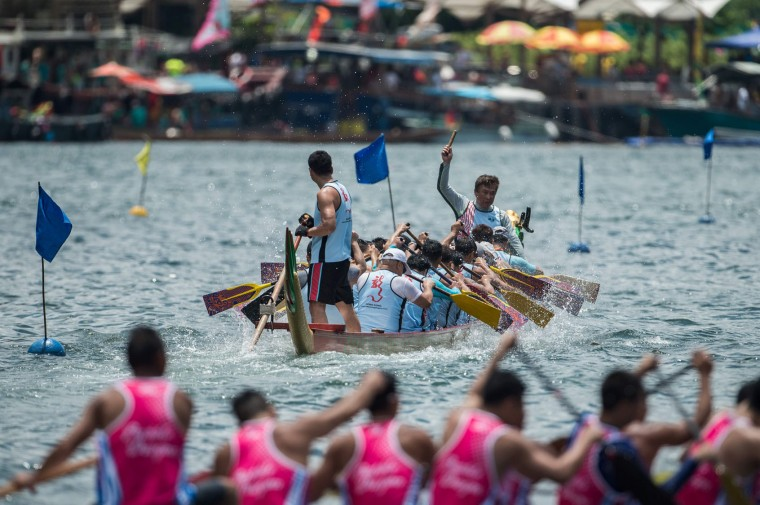 A drummer keeps the rhythm for his teammates as they take part in dragon boat races held to celebrate the Tuen Ng festival in Hong Kong on June 9, 2016. (Anthony Wallace/AFP/Getty Images)