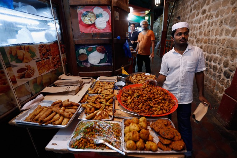 Vendors sell food during the holy month of Ramadan on June 15, 2016 in Dubai, United Arab Emirates. Muslim men and women across the world observe Ramadan, a month long celebration of self-purification and restraint. During Ramadan, the Muslim community fast, abstaining from food, drink, smoking and sex between sunrise and sunset, breaking their fast with an Iftar meal after sunset. (Photo by Francois Nel/Getty Images)