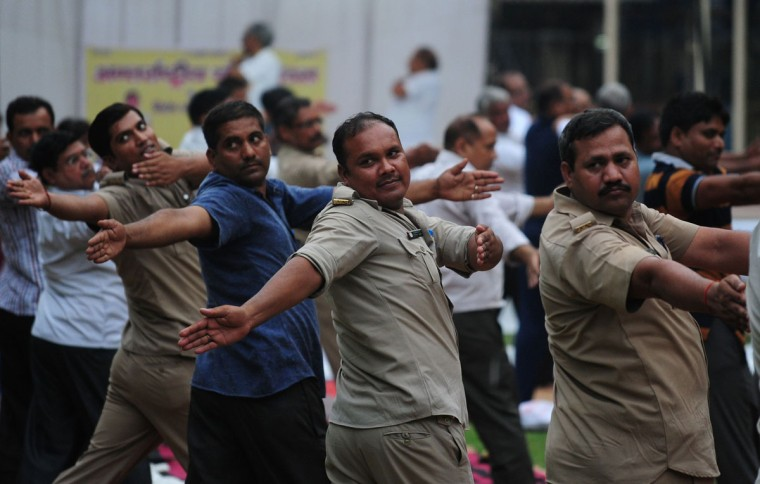 Indian U.p Policemen and officers perform Yoga at (PHQ) Police Head Quarter to mark International Yoga Day, in Allahabad on June 21, 2016. (AFP PHOTO / SANJAY KANOJIA)