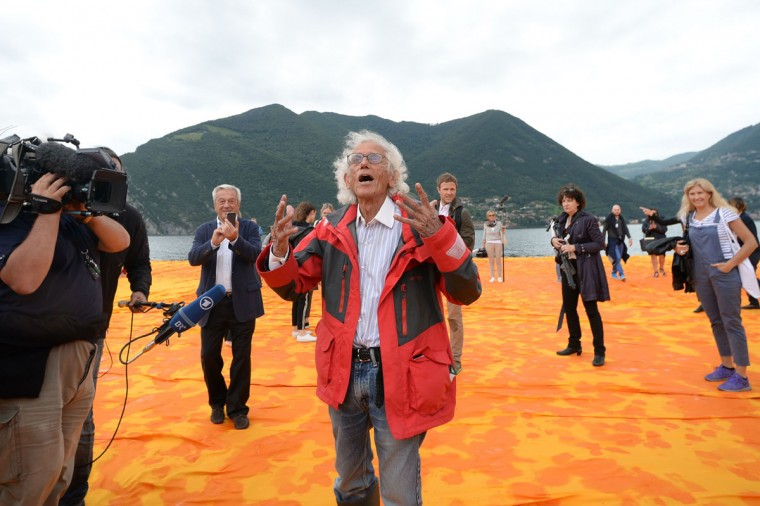 """Artist Christo Vladimirov Javacheff walks on his monumental installation """"The Floating Piers"""" he created with late Jeanne-Claude, on June 16, 2016 during a press preview at the lake Iseo, northern Italy. (FILIPPO MONTEFORTE/AFP/Getty Images)"""