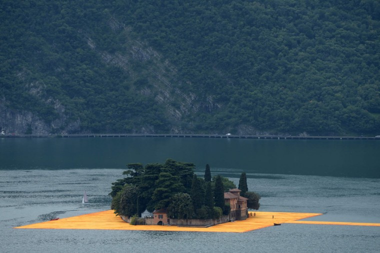 """A picture shows a partial view of the monumental installation """"The Floating Piers"""" created by artist Christo Vladimirov Javacheff and Jeanne-Claude, on June 16, 2016 during a press preview at the lake Iseo, northern Italy. (FILIPPO MONTEFORTE/AFP/Getty Images)"""