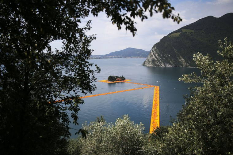 A view from above shows part of the monumental installation entitled 'The Floating Piers' created by artist Christo Vladimirov Javacheff on Iseo Lake, in northern Italy, on June 18, 2016. (MARCO BERTORELLO/AFP/Getty Images)