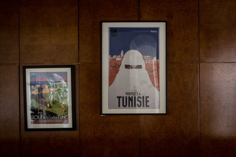 Posters promoting Tunisia are seen behind the reception desk at the closed Imperial Marhaba Hotel on June 24, 2016 in Sousse, Tunisia. The Imperial Marhaba hotel was the main target of the 2015 Sousse beach terrorist attack that killed 38 people including 30 Britons. The hotel attempted to stay open for three months after the attacks, however low occupancy forced the hotel to close. Since then it has operated with a skeleton staff, who work to maintain the rooms and grounds, other permanent hotel staff were able to be placed in temporary jobs at two other hotels owned by the same chain. The hotel hopes to open again by next spring or as soon as British travel advisories and restrictions are lifted for Tunisia. Before the 2011 revolution, tourism in Tunisia accounted for approximately 7% of the countries GDP. The two 2015 terrorist attacks at the Bardo Museum and Sousse Beach saw tourism numbers plummet even further forcing hotels to close and many tourism and hospitality workers to lose their jobs. The 26th of June 2016 marks the anniversary of the Sousse beach attacks. (Photo by Chris McGrath/Getty Images)