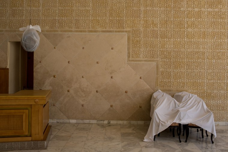 Chairs are seen covered with sheets at the closed Imperial Marhaba Hotel on June 24, 2016 in Sousse, Tunisia. The Imperial Marhaba hotel was the main target of the 2015 Sousse beach terrorist attack that killed 38 people including 30 Britons. The hotel attempted to stay open for three months after the attacks, however low occupancy forced the hotel to close. Since then it has operated with a skeleton staff, who work to maintain the rooms and grounds, other permanent hotel staff were able to be placed in temporary jobs at two other hotels owned by the same chain. The hotel hopes to open again by next spring or as soon as British travel advisories and restrictions are lifted for Tunisia. Before the 2011 revolution, tourism in Tunisia accounted for approximately 7% of the countries GDP. The two 2015 terrorist attacks at the Bardo Museum and Sousse Beach saw tourism numbers plummet even further forcing hotels to close and many tourism and hospitality workers to lose their jobs. The 26th of June 2016 marks the anniversary of the Sousse beach attacks. (Photo by Chris McGrath/Getty Images)