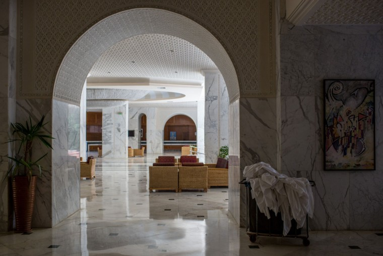 The general view of the lobby area at the closed Imperial Marhaba Hotel on June 24, 2016 in Sousse, Tunisia. The Imperial Marhaba hotel was the main target of the 2015 Sousse beach terrorist attack that killed 38 people including 30 Britons. The hotel attempted to stay open for three months after the attacks, however low occupancy forced the hotel to close. Since then it has operated with a skeleton staff, who work to maintain the rooms and grounds, other permanent hotel staff were able to be placed in temporary jobs at two other hotels owned by the same chain. The hotel hopes to open again by next spring or as soon as British travel advisories and restrictions are lifted for Tunisia. Before the 2011 revolution, tourism in Tunisia accounted for approximately 7% of the countries GDP. The two 2015 terrorist attacks at the Bardo Museum and Sousse Beach saw tourism numbers plummet even further forcing hotels to close and many tourism and hospitality workers to lose their jobs. The 26th of June 2016 marks the anniversary of the Sousse beach attacks. (Photo by Chris McGrath/Getty Images)