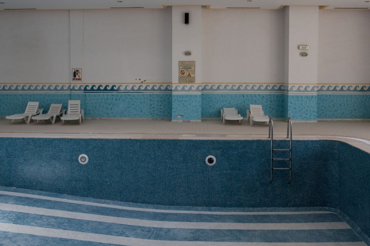 The empty indoor swimming pool is seen at the closed Imperial Marhaba Hotel on June 24, 2016 in Sousse, Tunisia. The Imperial Marhaba hotel was the main target of the 2015 Sousse beach terrorist attack that killed 38 people including 30 Britons. The hotel attempted to stay open for three months after the attacks, however low occupancy forced the hotel to close. Since then it has operated with a skeleton staff, who work to maintain the rooms and grounds, other permanent hotel staff were able to be placed in temporary jobs at two other hotels owned by the same chain. The hotel hopes to open again by next spring or as soon as British travel advisories and restrictions are lifted for Tunisia. Before the 2011 revolution, tourism in Tunisia accounted for approximately 7% of the countries GDP. The two 2015 terrorist attacks at the Bardo Museum and Sousse Beach saw tourism numbers plummet even further forcing hotels to close and many tourism and hospitality workers to lose their jobs. The 26th of June 2016 marks the anniversary of the Sousse beach attacks. (Photo by Chris McGrath/Getty Images)