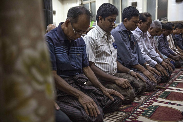 Myanmar Muslims attend the evening Maghrib prayer during Ramadan at the 59th Street Mosque in downtown on June 17, 2016 in Yangon, Burma. The Maghrib prayer is the final prayer before breaking fast in the evening. Ramadan is the 9th month in the Islamic calendar, observed by the Muslim community as a month of fasting. (Photo by Lauren DeCicca/Getty Images)