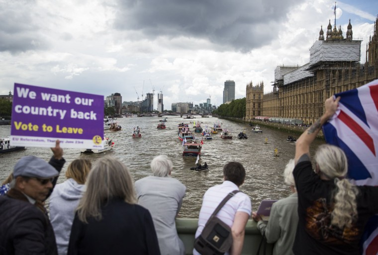LONDON, ENGLAND - JUNE 15: Supporters look on as boats from the 'Fishing for Leave' campaign group and boats from the 'In' campaign join a flotilla along the Thames River outside Parliament on June 15, 2016 in London, England. The flotilla organised by members of the Fishing for Leave group, who are campaigning to leave the European Union ahead of the referendum on the 23rd of June, was countered by boats representing the 'In' campaign. (Photo by Jack Taylor/Getty Images)