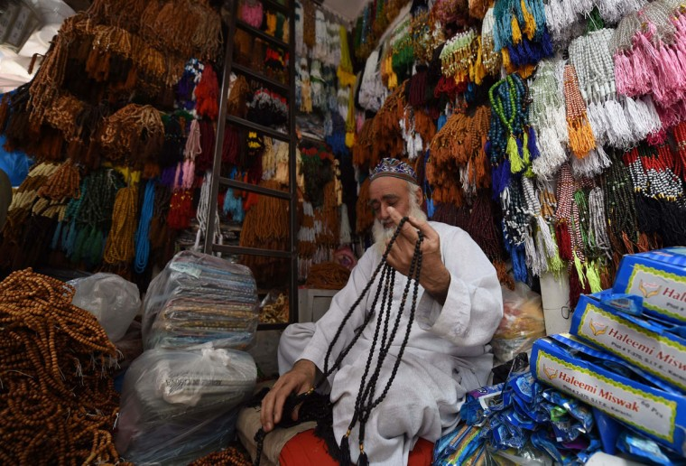 A Pakistani vendor arranges rosary beads at his shop ahead of the Islamic holy month of Ramadan in Peshawar on June 2, 2016. Muslims are preparing for Islam's holy month of Ramadan, which is calculated on the sighting of the new moon, and during which they fast from dawn until dusk. / (AFP Photo/A Majeed)