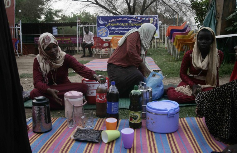 Sudanese women arrive to share a picnic at a park on Nile Street as they break the fast during the Muslim holy fasting month of Ramadan on June 17, 2016 in the capital Khartoum. (Ebrahim Hamid/AFP/Getty Images)