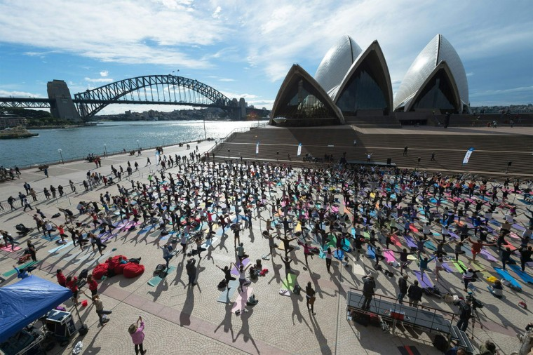 Sydneysiders engage in a yoga event in front of the iconic landmark Opera House in Sydney on June 21, 2016. Hundreds of Yoga lovers gathered at Opera House to mark the International Yoga Day. (AFP PHOTO / Wendell Teodoro)