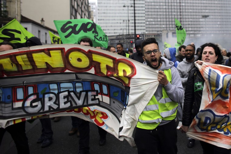 Labor union members on strike with a poster reading 'Railway workers from St Lazare station on strike!' shout slogans as they attend a demonstration against the French government and labor law reforms in Paris, Thursday, June 2, 2016. Workers are on strike at nearly all of France's nuclear plants and on the national rail service as part of months of protests over changes to labor protections. (AP Photo/Markus Schreiber)