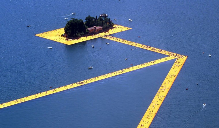 An aerial view of the installation 'The Floating Piers' by Bulgarian-born artist Christo Vladimirov Yavachev known as Christo, on the Lake Iseo, northern Italy, Saturday, June 18, 2016. (Filippo Venezia/Ansa via AP)
