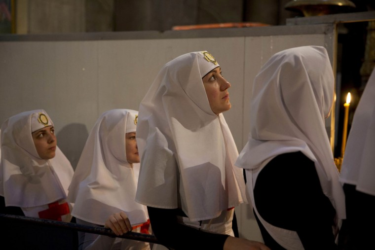Christian nuns watch as a team of experts begin the renovation of Jesus' tomb in the Church of the Holy Sepulchre in Jerusalem's old city, Monday, June 6, 2016. A team of experts has begun a historic renovation at the spot where Christians believe Jesus was buried, overcoming longstanding religious rivalries to carry out the first repairs at the site in over 200 years. (AP Photo/Ariel Schalit)