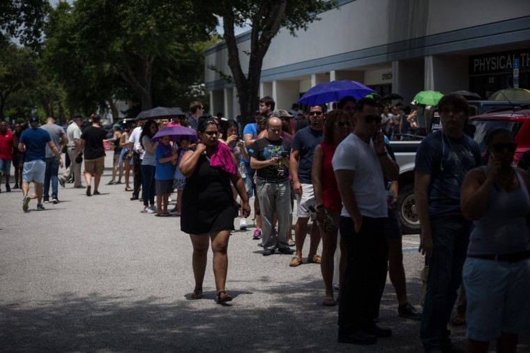 Donors line up outside OneBlood Blood Donation Center in Orlando, Fla., on Sunday, June 12, 2016. The center was flooded with donors after a mass shooting early Sunday morning at a gay nightclub, Pulse, in Orlando. A gunman wielding an assault-type rifle and a handgun opened fire inside the nightclub early Sunday, killing at least 50 people before dying in a gunfight with SWAT officers, police said. It was the worst mass shooting in American history. (Loren Elliott/Tampa Bay Times via AP)