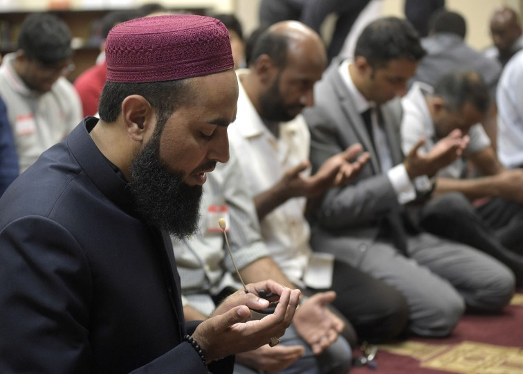 Imam Azhar Subedar, left, speaks during a special prayer with non-Muslim members of the community at the American Muslim Community Center Monday, June 13, 2016, in Longwood, Fla., after the mass-shooting at the Pulse Orlando nightclub. Dozens of people were killed at the gay nightclub in the deadliest shooting in modern U.S. history. (AP Photo/Phelan M. Ebenhack)