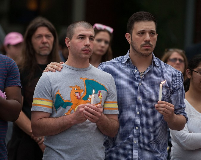 "People attend a ""Stand with Orlando"" vigil held by the LGBT Center of Central PA in Harrisburg, Pa., Monday, June 13, 2016. Vigils, rallies and marches are being held around the country Monday for the victims of early Sunday's deadly attack at a gay nightclub in Orlando. (Vicki Vellios Briner/PennLive.com via AP)"