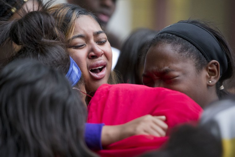 Mourners from West Catholic Preparatory High School embrace during a vigil in memory of the victims of the Orlando, Fla., mass shooting, including their former classmate Akyra Murray, Monday, June 13, 2016, at City Hall in Philadelphia. A gunman opened fire inside a crowded gay nightclub early Sunday, before dying in a gunfight with SWAT officers, police said. (AP Photo/Matt Rourke)