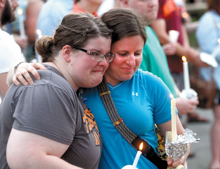 Tracy Trentham, left, gets a hug from Emily Randles after the candlelight vigil for victims of the Orlando mass shooting held on the Maryville greenbelt, Monday, June 13, 2016, in Maryville, Tenn. A gunman killed dozens of people in a massacre at a crowded gay nightclub in Orlando on Sunday, making it the deadliest mass shooting in modern U.S. history. (Tom Sherlin/The Daily Times via AP)