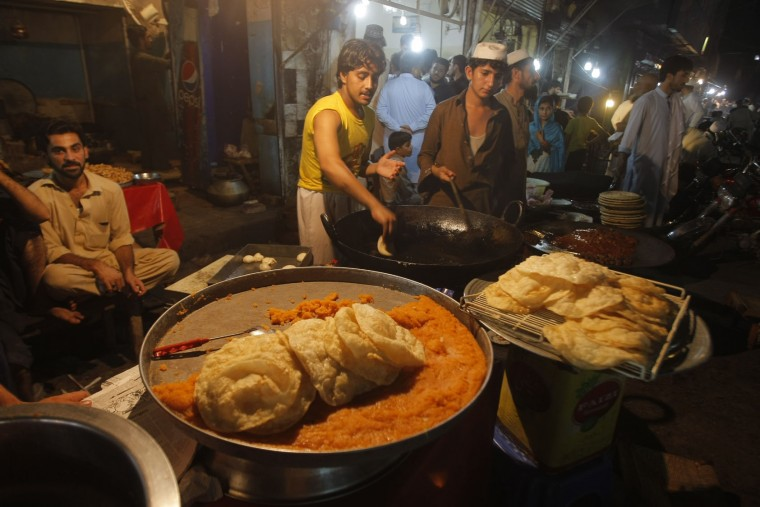 Pakistani vendors prepare food for customers during the Islamic month of Ramadan in Peshawar, Pakistan, Friday, June 17, 2016. Muslims across the world are observing the holy fasting month of Ramadan, when they refrain from eating, drinking and smoking from dawn to dusk. (AP Photo/Mohammad Sajjad)