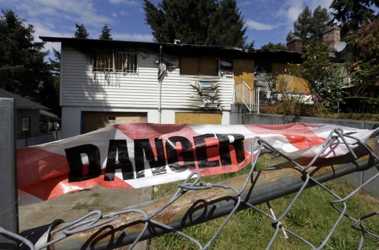 "A fire-damaged, abandoned and boarded-up house stands in Portland, Ore., Tuesday, June 14, 2016. City officials in this booming Pacific Northwest metropolis have developed a plan to foreclose on so-called ""zombie homes"" for first time in 50 years as Portland grapples with a swelling population and skyrocketing home costs that threaten to lock new homeowners out of the market. (AP Photo/Don Ryan)"