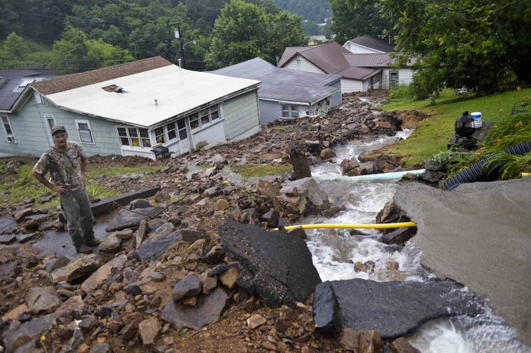 Rob Morissin stands among the aftermath of a rockslide caused by severe flooding that poured into a property owned by his family since the 1930's in Richwood, W.Va. on Friday June 24, 2016. (Christian Tyler Randolph/Charleston Gazette-Mail via AP)
