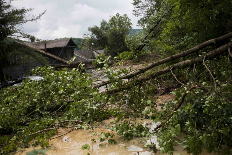 Rock, mud, trees, downed power lines and other debris litter the road on Main Street leading into Richwood, W.Va. after severe flooding and multiple rockslides on Friday June 24, 2016. (Christian Tyler Randolph/Charleston Gazette-Mail via AP)