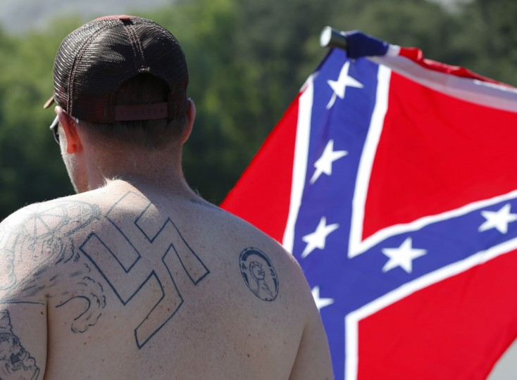 In this Saturday, April 27, 2016 photo, supporters of the Confederate flag, who were expecting the Ku Klux Klan to show up, participate in a rally at Stone Mountain Park in Stone Mountain, Ga. Klan leaders say they feel that U.S. politics are going their way, as a nationalist, us-against-them mentality deepens across the nation. (AP Photo/John Bazemore)