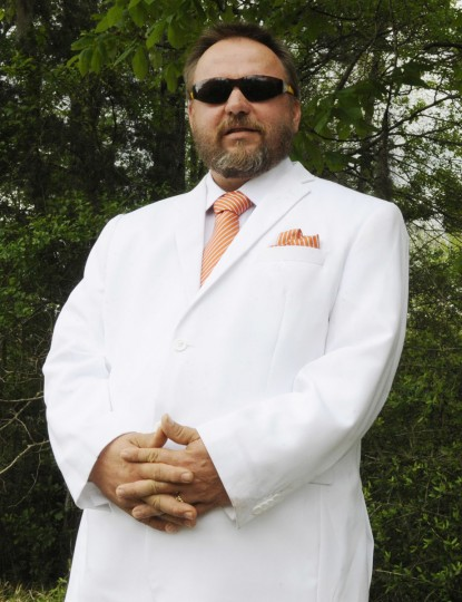 This April 28, 2016 photo shows Brent Waller, Mississippi grand dragon and spokesman for the Tennessee-based Ku Klos Knights of the Ku Klux Klan. Waller has since become the imperial wizard of the United Dixie White Knights of the Ku Klux Klan. He has boyhood memories of flaming crosses and of Sam Bowers, a Klan boss who served six years in prison for his role directing the murders of three civil rights workers in 1964, and who later was convicted of killing a civil rights leader in 1966. (AP Photo/Jay Reeves)