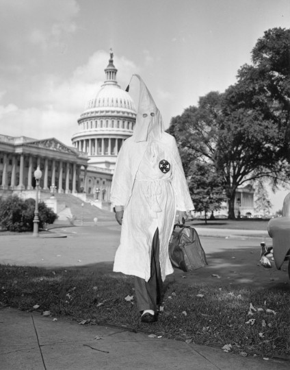 In this Sept. 10, 1947 file photo, Ku Klux Klan member Stetson Kennedy, 30, of Jacksonville, Fla., walks away from the U.S. Capitol building in Washington. Police had escorted him out of the Un-American Activities Committee room. (AP Photo/File)