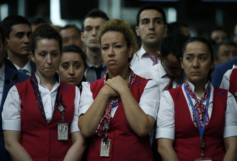Family members, colleagues and friends of the victims of Tuesday blasts gather for a memorial ceremony at the Ataturk Airport in Istanbul, Thursday, June 30, 2016. A senior Turkish official on Thursday identified the Istanbul airport attackers as a Russian, Uzbek and Kyrgyz national hours after police carried out sweeping raids across the city looking for Islamic State suspects. Tuesday's gunfire and suicide bombing attack at Ataturk Airport killed dozens and injured over 200. Turkish authorities have banned distribution of images relating to the Ataturk airport attack within Turkey. (AP Photo/Emrah Gurel)