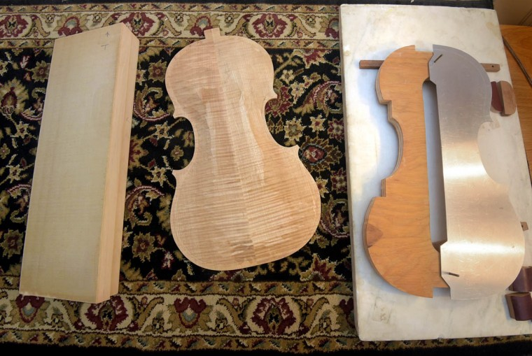 Pictured is a viola in the making. At left is quartered spruce that will be the top. In the center is the partially carved back made of maple. At right is an interior mold and template for forming the sides of the viola. Perrin and Associates Fine Violins, founded in 1994, make, repair and restore violins and cellos for the aspiring to the accomplished musician. (Algerina Perna/Baltimore Sun)
